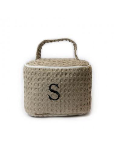 Customizable oval beauty case in sand waffle weave