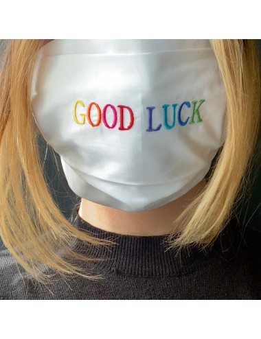 """Mask in white percale with embroidered """"Good Luck"""" drawing"""