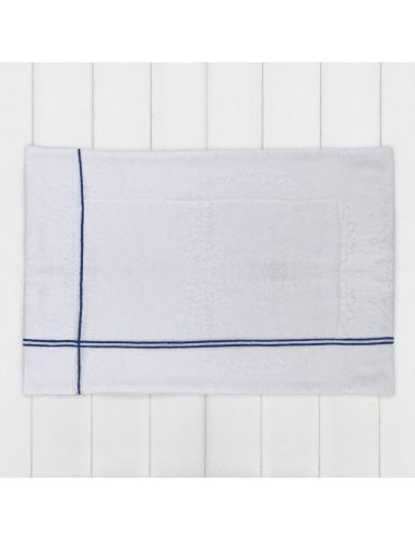 Customizable blue terry cloth bath mat with white grosgrain crossings