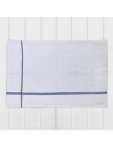 Tappetino in spugna bianca con incroci blu