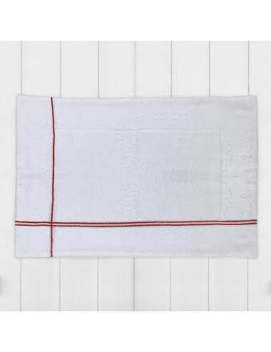 Tappetino in spugna bianca con incroci rosso