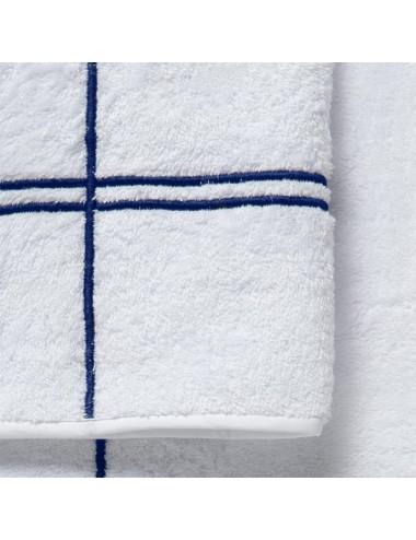 Coppia asciugamani in spugna bianca con incroci blu