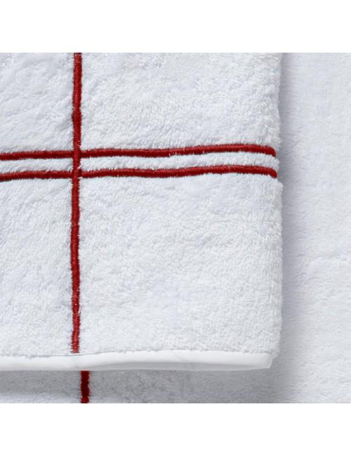 Coppia asciugamani in spugna bianca con incroci rossi