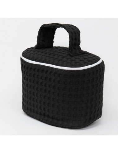 Customizable oval beauty case in black waffle weave